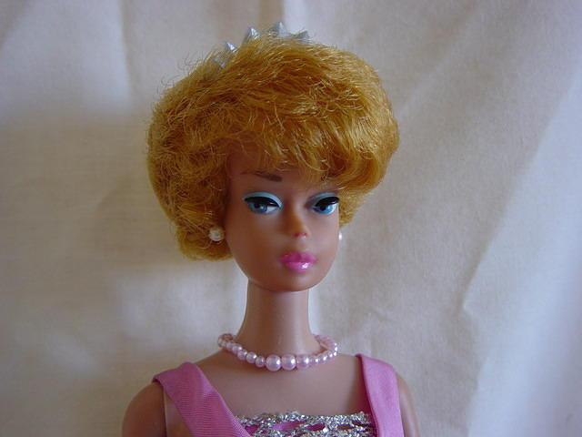 "I prefer the fashion on a pink lipped doll as the bright ""Lucy"" red can often look too harsh."