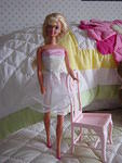 This 1990s era ballerina barbie came to me nude.  I dressed her in an unknown 1980s ballet dress.